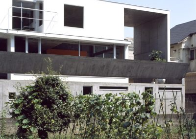 Concrete-home-by-Takuro-Yamamoto-Architects-overlooks-an-allotment-and-woods-near-Tokyo-3