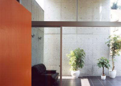 Concrete-home-by-Takuro-Yamamoto-Architects-overlooks-an-allotment-and-woods-near-Tokyo-4