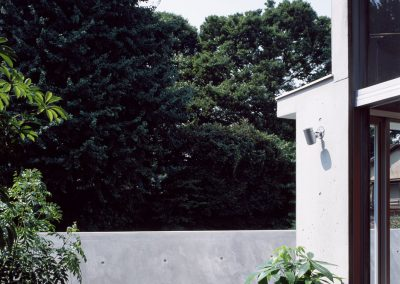 Concrete-home-by-Takuro-Yamamoto-Architects-overlooks-an-allotment-and-woods-near-Tokyo-5